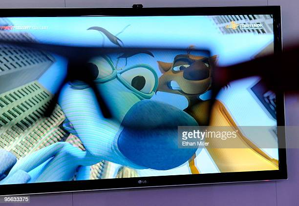 A movie image is partially seen through 3D glasses on a 72' 3D LCD full LED slim television at the LG Electronics booth at the 2010 International...