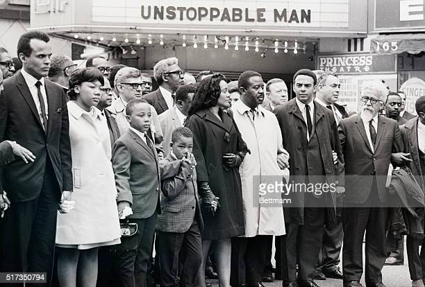 A movie marquee provides an ironic touch for a memorial march for slain civil rights leader Dr Martin Luther King Jr April 8 1968 In front row are...