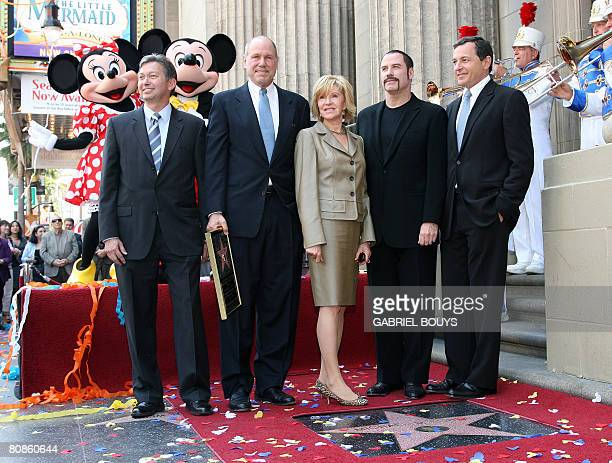 Movie mogul Michael D Eisner poses with Hollywood chamber of commerce President Leron Gubler his wife Jane Breckenridge actor John Travolta and Bob...