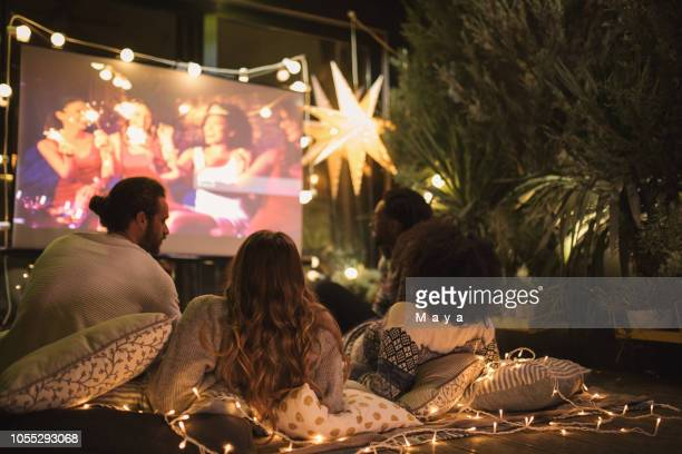 movie night at back yard - outdoor party stock pictures, royalty-free photos & images