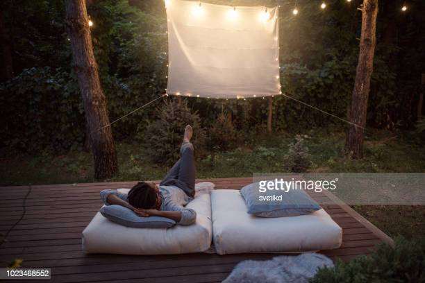 movie night at porch - projection equipment stock pictures, royalty-free photos & images