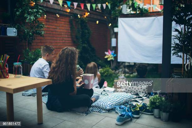 movie night in backyard - film stock pictures, royalty-free photos & images