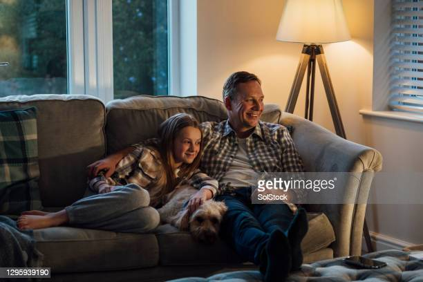 movie night with dad - film stock pictures, royalty-free photos & images