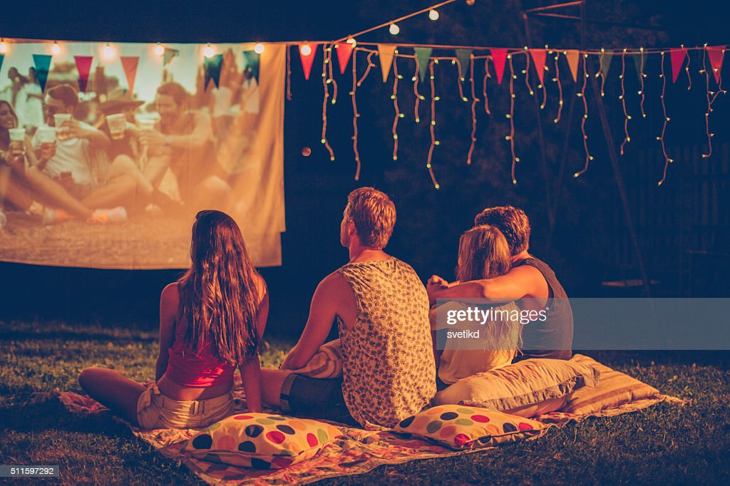 Movie night with friends : Stock Photo