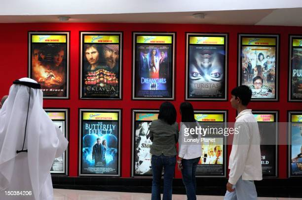 movie patrons, deira city centre. - movie poster stock photos and pictures