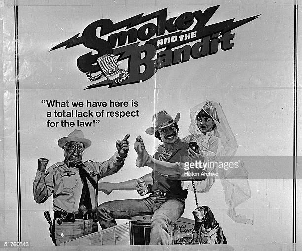 A movie poster for the film 'Smokey and the Bandit' features American actors Jackie Gleason Burt Reynolds and Sally Field 1977