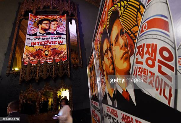 """Movie posters for the premiere of the film """"The Interview"""" at The Theatre at Ace Hotel in Los Angeles, California on December 11, 2014. The film,..."""