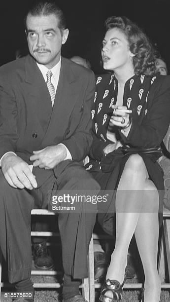 Movie producer and aviation executive Howard Hughes and Ava Gardner are shown at ringside during the title bout between Heavyweight champion Joe...