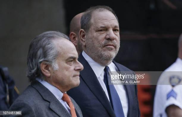 Movie producer Harvey Weinstein departs Manhattan Supreme Court in New York with his lawyer Benjamin Brafman in New York on December 20 after a...