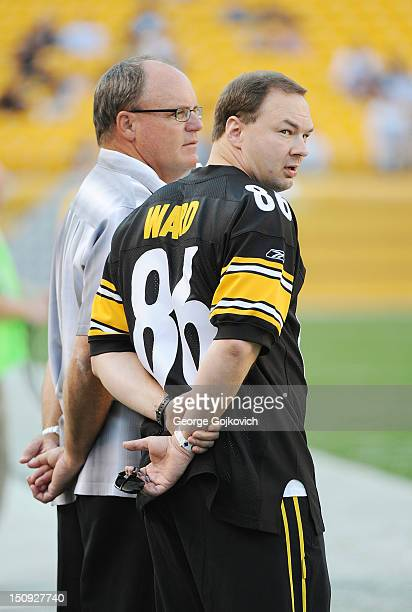 Movie producer Thomas Tull president and CEO of Legendary Pictures and a part owner of the Pittsburgh Steelers looks on from the sideline while...