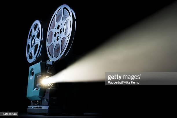 Movie projector with beam of light