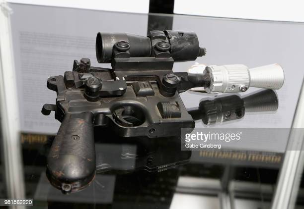A movie prop of a BlasTech DL44 blaster used by the character Han Solo in the movie Return of the Jedi is displayed during a preview for Julien's...