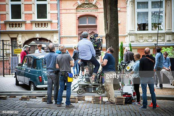 movie set on a street in wiesbaden - filmen stockfoto's en -beelden