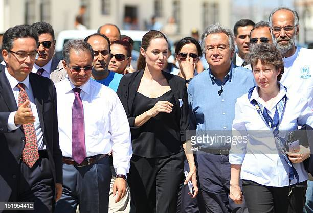 US movie star and UN special envoy Angelina Jolie arrives with UN High Commissioner for Refugees Antonio Guterres on September 13 2012 at a refugee...