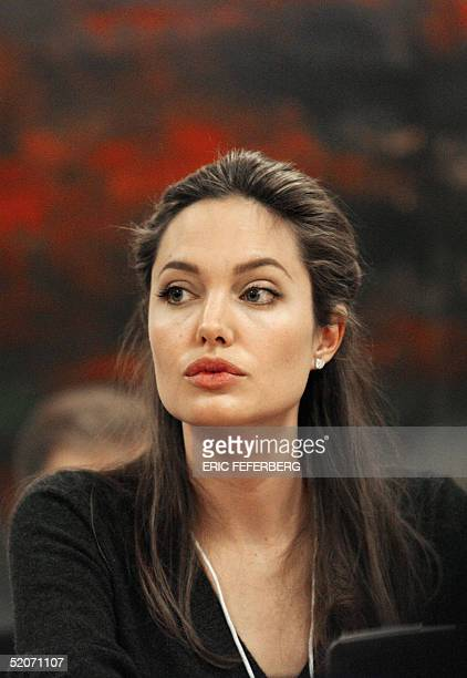 US movie star Angelina Jolie listens during the session 'Getting the Millienium development goals back on track' at the World Economic Forum in Davos...