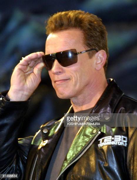 US movie star Arnold Schwarzenegger puts on his sunglass prior to his press conference with other Universal Studio officials after the World Premiere...