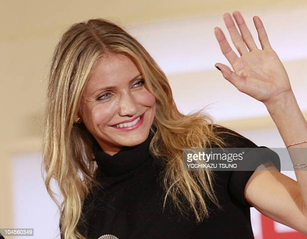 US movie star Cameron Diaz waves to Japanese fans upon her arrival at the Japan premiere of their film 'Knight and Day' in Tokyo on September 28 2010...