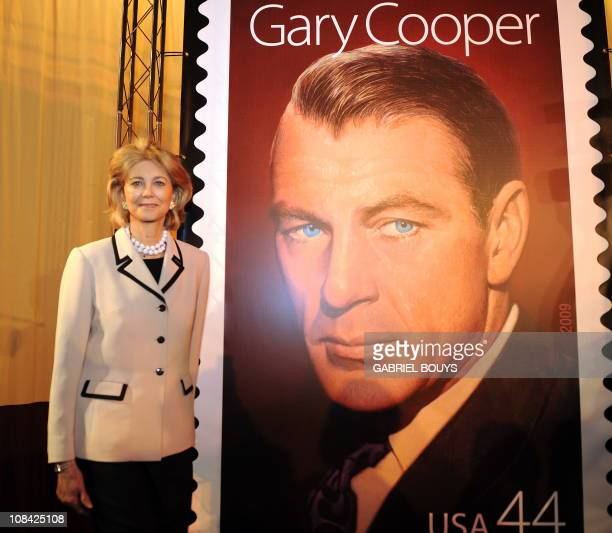 Movie star Gary Cooper's daughter Maria Cooper Janis poses nextto the stamp in tribute to her father in Los Angeles California after a ceremony to...
