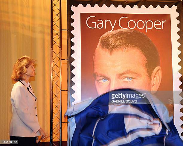 Movie star Gary Cooper's daughter Maria Cooper Janis unveils the stamp in tribute to her father in Los Angeles California after a ceremony to...