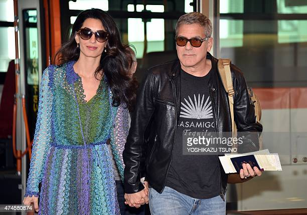 US movie star George Clooney accompanied by his wife Amal arrives at Haneda airport in Tokyo on May 24 2015 Clooney is now here for the Japanese...