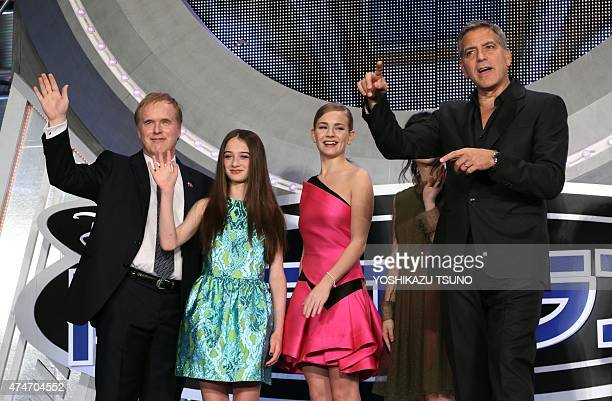 US movie star George Clooney US actress Britt Robertson British actress Raffey Cassidy and US film director Brad Bird smile at the Japan premiere of...