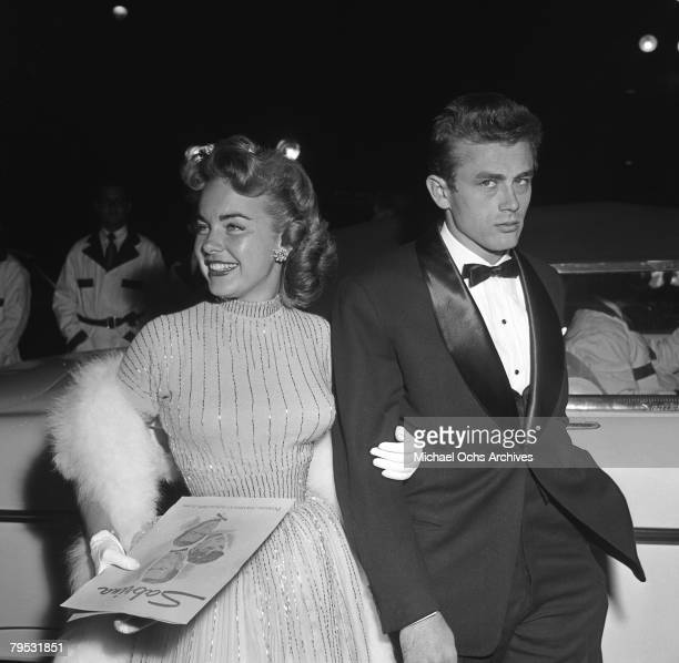 Movie star James Dean and actress Terry Moore attend the Premiere of Sabrina on September 22 1954 in Los Angeles California