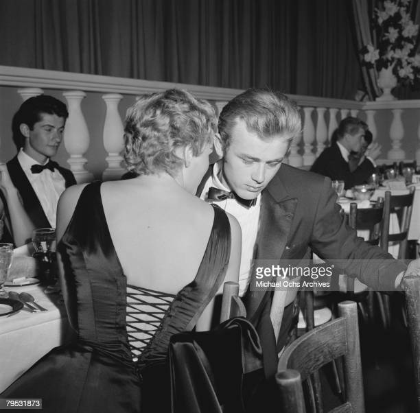 Movie star James Dean and Swiss born actress Ursula Andress attend the Thalian Ball on August 29 1955 at Ciro's nightclub in Los Angeles California...