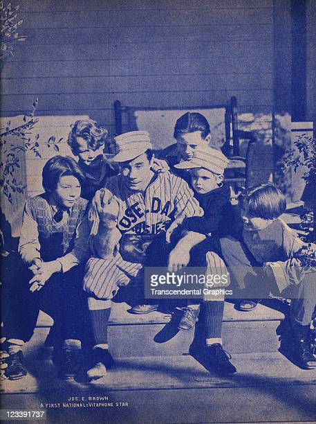 Movie star Joe E Brown poses in his baseball uniform with costars George Ernest Dickie Moore Ginger Connolly and others on the set of the First...