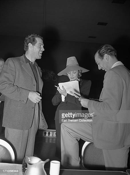 Movie stars Fred MacMurray and Marlene Dietrich rehearse the radio play 'Desire' a charity radio series for the Screen Guild's Motion Picture Relief...