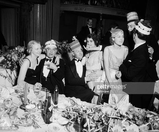 Movie stars Virginia Bruce Cliff Edwards Clarence Brown Nancy Dover and their party bring in the new year at the Coconut Grove in LA