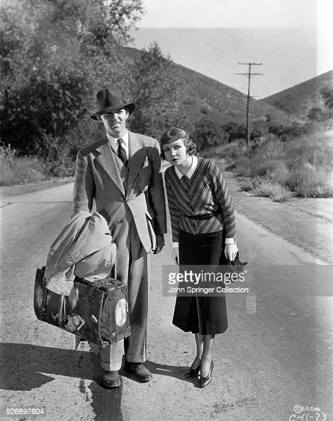 Movie still from the 1934 film It Happened One Night In this scene Claude Colbert and Clark Gable are shown hitchhiking