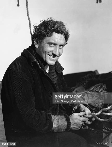 Movie still from the 1937 film Captain Courageous In this scene Spencer tracy is shown smiling broadly and sitting