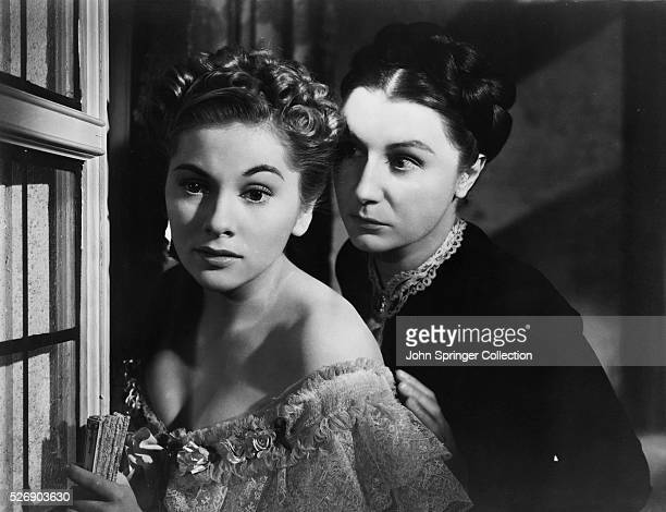 Movie still from the 1940 film Rebecca In this scene Joan Fontaine and Judith Anderson are shown looking out of window