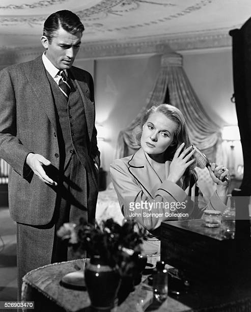 Movie still from the 1947 film 'The Paradine Case' In this scene Gregory Peck talks to a seated Ann Todd