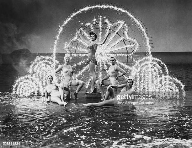 Movie still from the 1952 film Million Dollar Mermaid In this scene Esther Williams poses atop a a platform in a watery setting