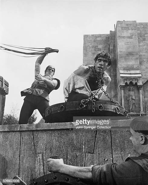 Movie still from the 1957 film adaptation of Victor Hugo's novel The Hunchback of Notre Dame In this scene Anthony Quinn as Quasimodo is flogged as...