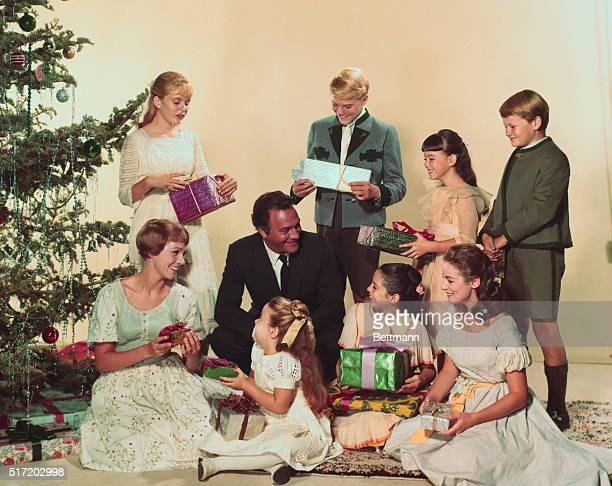 Movie still from the 1965 film The Sound of Music starring Julie Andrews and Christopher Plummer All the Von Trapp children gathered to open presents