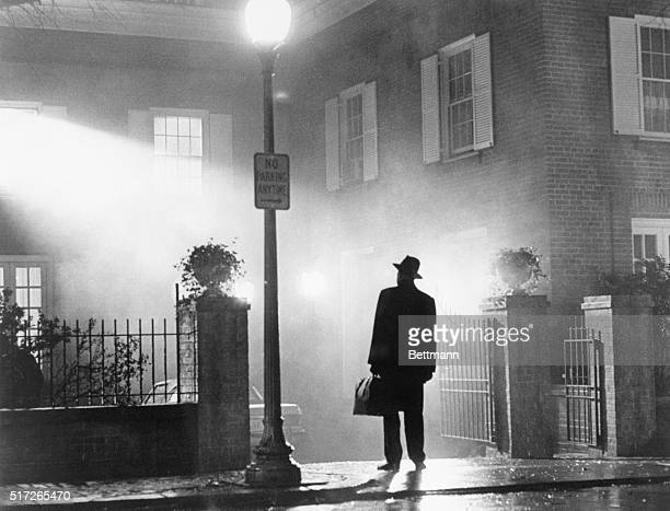 1973 Movie still from The Exorcist showing Max Von Sydow standing outside the McNeil home This photograph was the one used in the advertising...