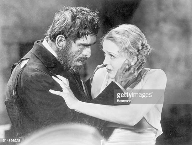Movie still from the film The Old Dark House shows Boris Karloff in monster makeup with his hand on Gloria Stewart's face Released in 1932