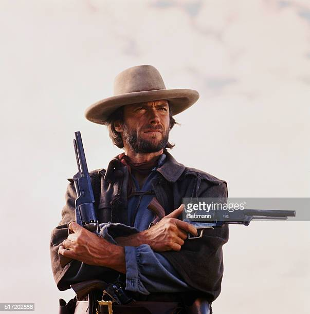 Movie still of Clint Eastwood starring in the 1976 Western The Outlaw Josey Wales directed by Clint Eastwood himself Photo shows him from the waistup...
