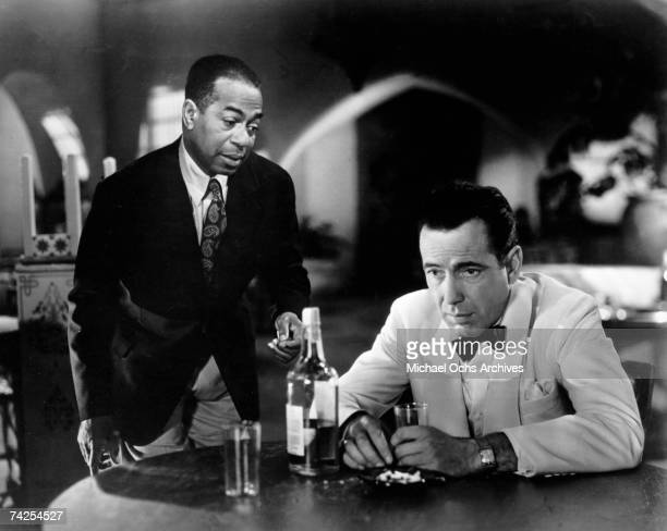 A movie still of Humphrey Bogart and Dooley Wilson on the set of the Warner Bros classic film 'Casablanca' in 1942 in Los Angeles California