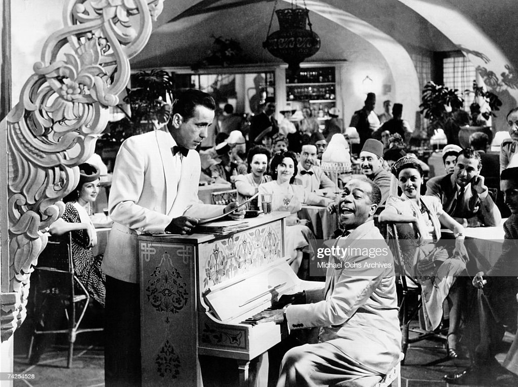 A movie still of Humphrey Bogart and Dooley Wilson on the set of the Warner Bros classic film 'Casablanca' in 1942 in Los Angeles, California.
