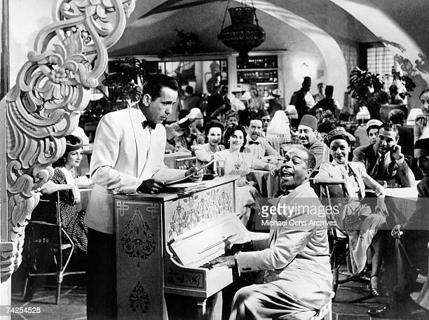 Movie still of Humphrey Bogart and Dooley Wilson on the set of the Warner Bros classic film 'Casablanca' in 1942 in Los Angeles, California.