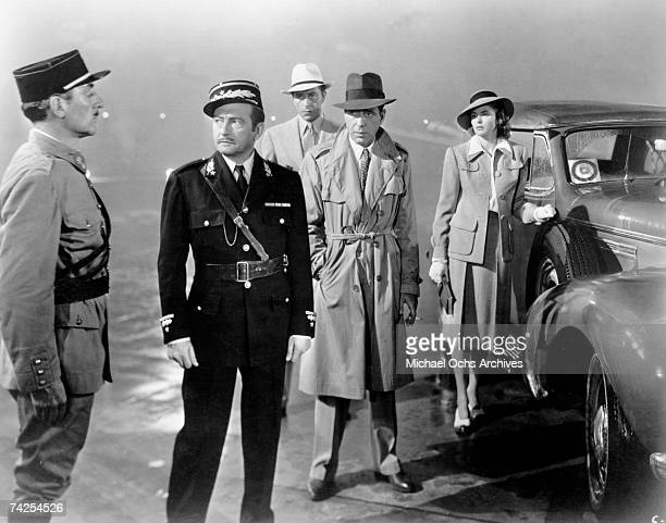 A movie still of Unidentified Claude Rains Paul Henreid Humphrey Bogart and Ingrid Bergman on the set of the Warner Bros classic film 'Casablanca' in...