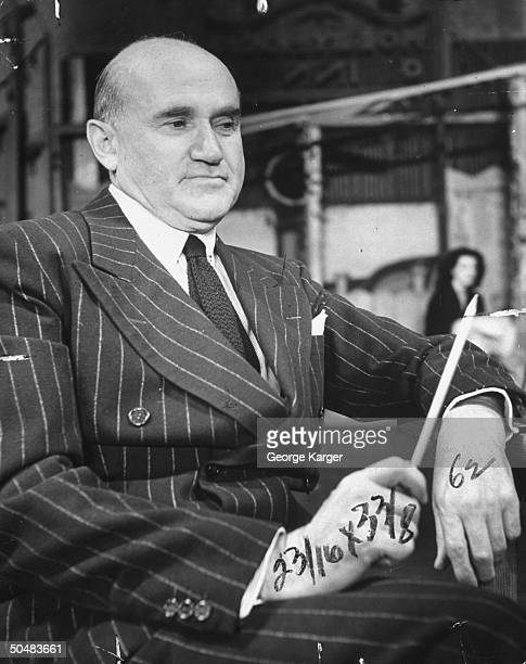 Movie studio owner Samuel Goldwyn posing for a picture.