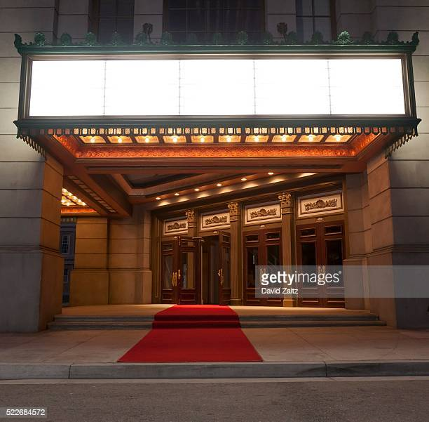 movie theater entrance and marquee - film premiere stock-fotos und bilder