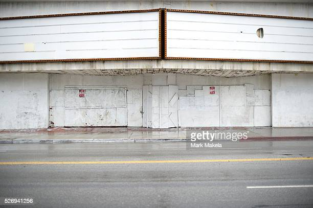 A movie theater is boarded up and out of business in Los Angeles CA on March 1 2014