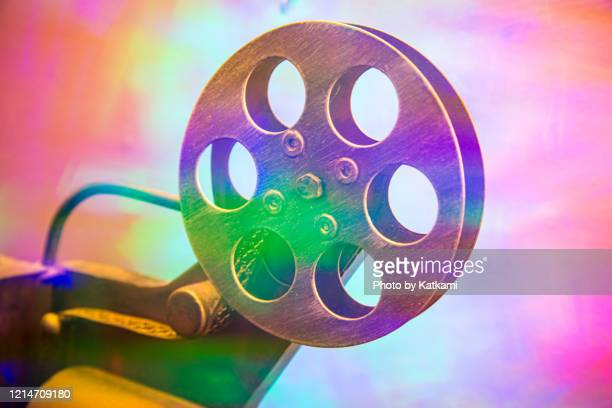 movie theater reel with light effects - フィルムリール ストックフォトと画像