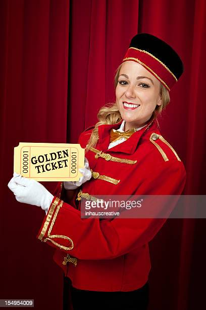 Movie theater usher holding a golden ticket