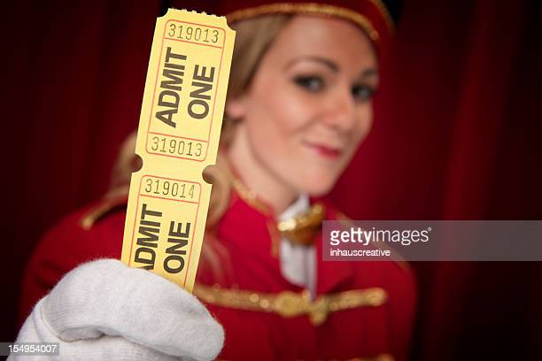Movie theater usher holding tickets that says ADMIT ONE